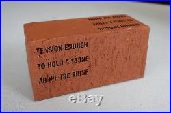 LAWRENCE WEINER, Tension enough to hold a stone above the rhine, Multiple